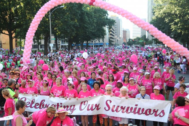 Breast cancer survivors join more than 15,000 others to walk through the streets of downtown St. Louis during the 18th annual the Susan G. Komen Race for the Cure on June 11, 2016. Photo by Bill Greenblatt/UPI