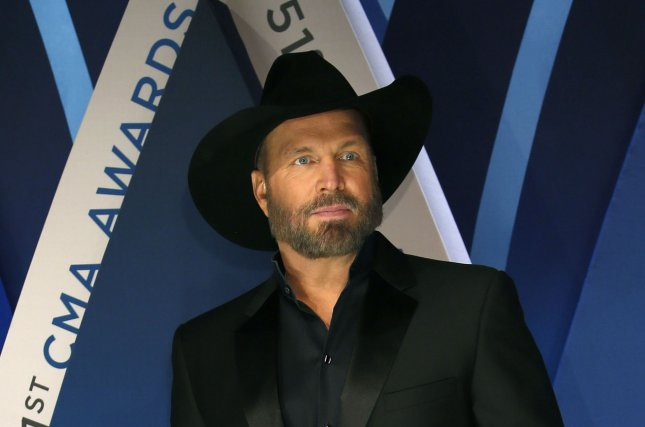 Garth Brooks walks the red carpet as he arrives for the 51st Annual Country Music Association Awards on November 8 at the Bridgestone Arena in Nashville. The country singer turns 56 on February 7. File Photo by John Sommers II/UPI