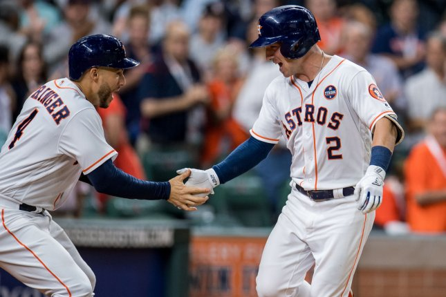 Alex Bregman of the Houston Astros celebrates with George Springer after hitting a two-run home run against the Minnesota Twins in the 3rd inning on Wednesday at Minute Maid Park in Houston. Photo by Trask Smith/UPI