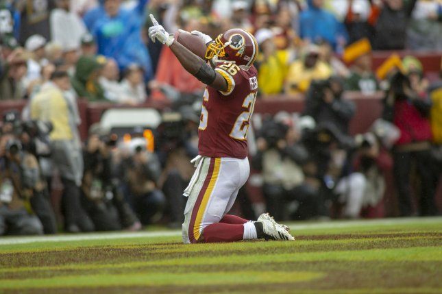 Washington Redskins running back Adrian Peterson (26) celebrates in the end zone after scoring a touchdown against the Green Bay Packers on September 23, 2018 at FedEx Field in Landover, Maryland. Photo by Alex Edelman/UPI