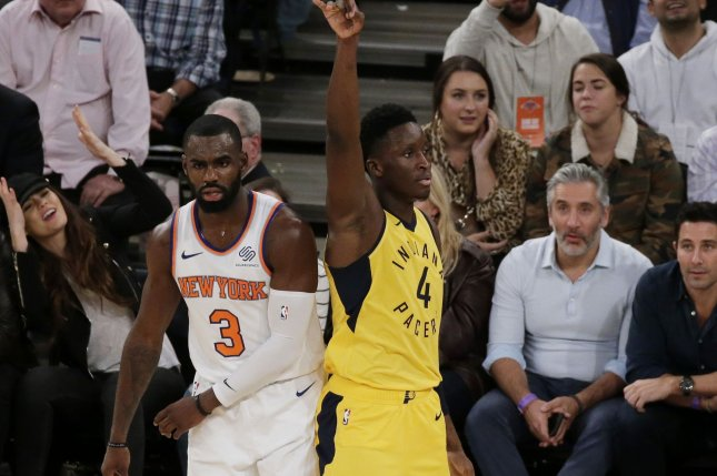 New York Knicks guard Tim Hardaway Jr. reacts as Indiana Pacers star Victor Oladipo makes a basket in the 4th quarter on October 31 at Madison Square Garden in New York City. Photo by John Angelillo/UPI