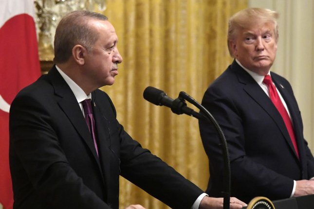 President Donald Trump looks to Turkish President Recep Tayyip Erdogan Wednesday during a joint news conference in the East Room of the White House. Photo by Mike Theiler/UPI