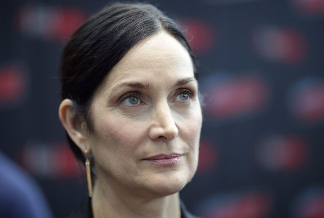 Carrie-Anne Moss of the series Tell Me a Story arrives for photos at New York Comic Con on October 3. File Photo by John Angelillo/UPI