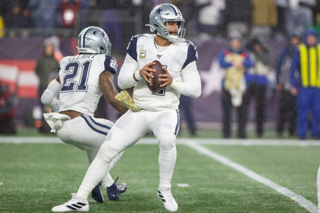 Dallas Cowboys legend Troy Aikman thinks current quarterback Dak Prescott (C) will get a lucrative contract extension before a July 15 deadline. File Photo by Matthew Healey/UPI