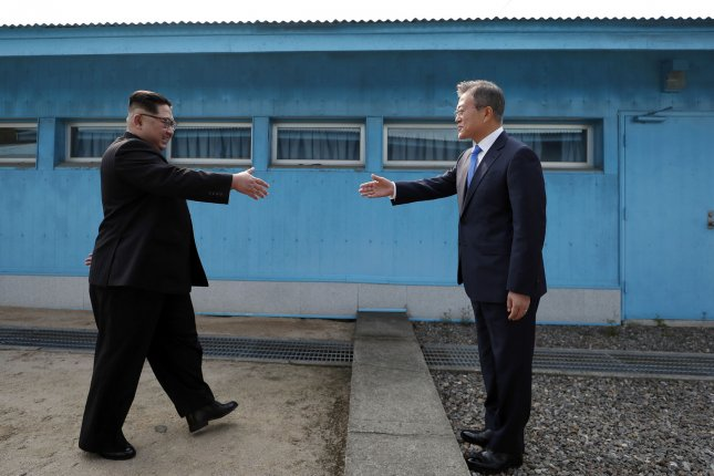South Korean President Moon Jae-in (R) has proposed that the United States sign a peace declaration ending the 1950-53 Korean War with North Korea. File Photo by Inter-Korean Summit Press Corps/UPI