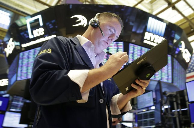The S&P 500 snapped a three-day losing streak on Wednesday after the Labor Department reported rising inflation in September and the Federal Reserve hinted at plans to taper its easy money policy.File Photo by John Angelillo/UPI
