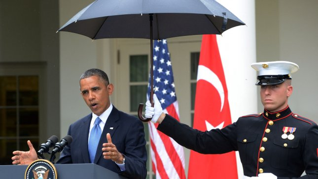 U.S. President Barack Obama answers a question during a joint press conference with Turkish Prime Minister Recep Tayyip Erdogan in a light rain in the Rose Garden of the White House in Washington, DC on May 16, 2013. The American and Turkey flags are in the background. The two world leaders discussed the Syria situation and answered questions on a range of subjects. UPI/Pat Benic