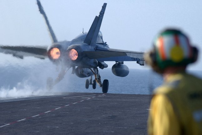An F/A-18 Hornet from Fighter Attack Squadron (VFA) 192 Golden Dragons part of Carrier Air Wing (CVW) 5, launches from USS Kitty Hawk's flight deck December 2, 2001 during flight operations in support of Operation Enduring Freedom. U.S. Navy photo by John E. Woods/UPI