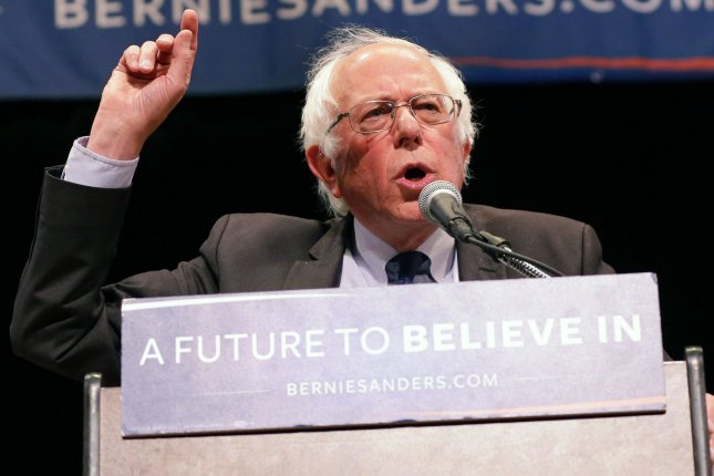 Democratic presidential candidate Sen. Bernie Sanders speaks at The Town Hall on Thursday in New York City. He also appeared on The Late Show with Stephen Colbert, saying it is embarrassing to explain American gun control laws to voters. Photo by John Angelillo/UPI