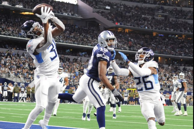 e121a8d17 Tennessee Titans Kevin Byard intercepts a pass from Cowboys QB Dak Prescott  in the end zone Monday night during the first half at AT&T Stadium in  Arlington, ...