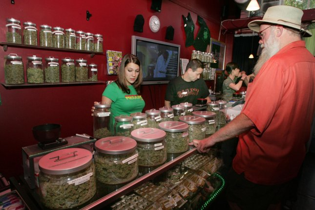 As more in the U.S. use marijuana for medical treatment, some concern has been raised about the lack of rigorous research available on its efficacy. Pictured, a customer is helped at a medicinal cannabis shop in San Francisco in June 2005. File Photo by Terry Schmitt/UPI