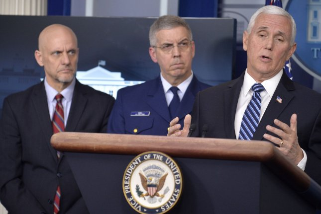 Vice President Mike Pence (R) makes remarks as FDA Commissioner Stephen Hahn (L) and Coast Guard Vice Admiral Daniel Abel listen during a briefing on the coronavirus Friday at the White House. Photo by Mike Theiler/UPI