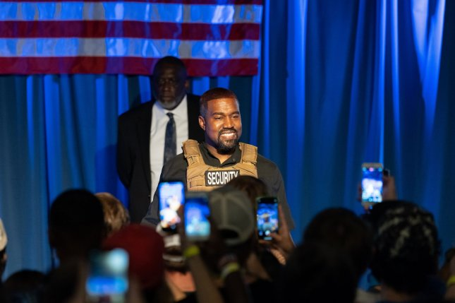 Rapper Kanye West wears a bulletproof vest on stage at his first presidential campaign event Sunday in North Charleston, S.C. Photo by Richard Ellis/UPI
