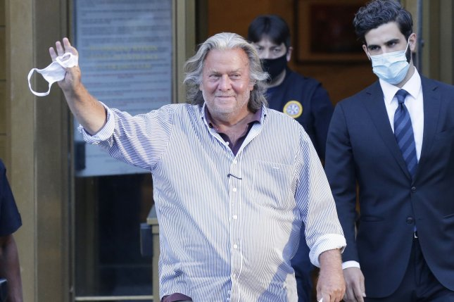 Former White House chief strategist Steve Bannon waves and smiles Thursday as he exits a federal court in New York City. Photo by John Angelillo/UPI