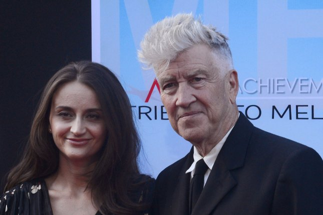David Lynch (R) and wife Emily Stofle at the AFI Life Achievement Award ceremony for Mel Brooks on June 6, 2013. The director shared a first teaser for the 'Twin Peaks' revival Friday. File Photo by Jim Ruymen/UPI