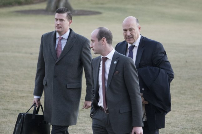 White House Staff Secretary Rob Porter, left, walks with Senior Advisor Stephen Miller, center, and Director of the National Economic Council Gary Cohn, right, walk at the White House on January 18. Porter resigned his position on Wednesday after two former wives alleged his physical, emotional and verbal abuse. Photo by Ron Sachs/UPI