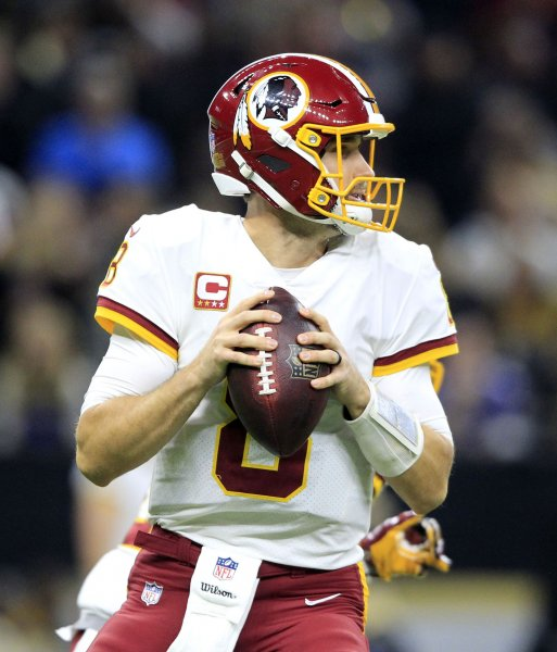 Washington Redskins quarterback Kirk Cousins fades back to pass in a game against the New Orleans Saints in November. Photo by AJ Sisco/UPI