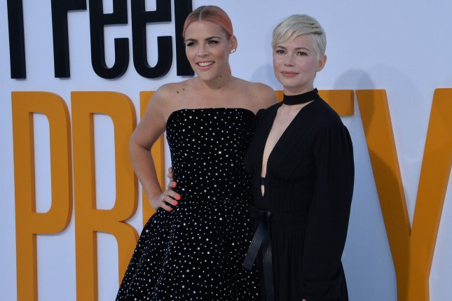 Michelle Williams (R) and Busy Philipps attend the Los Angeles premiere of I Feel Pretty on Tuesday. Photo by Jim Ruymen/UPI