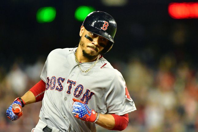 Boston Red Sox right fielder Mookie Betts runs the bases after hitting a solo home run against the Washington Nationals in the seventh inning on July 2 at Nationals Park in Washington, D.C. Photo by Kevin Dietsch/UPI