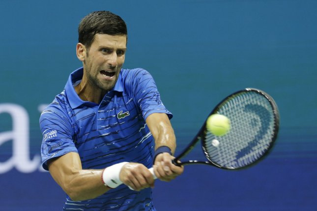 Novak Djokovic of Serbia hits a backhand in his second-round match against Juan Ignacio Londero of Argentina on Wednesday in Arthur Ashe Stadium at the 2019 US Open Tennis Championships at the USTA Billie Jean King National Tennis Center. Photo by John Angelillo/UPI