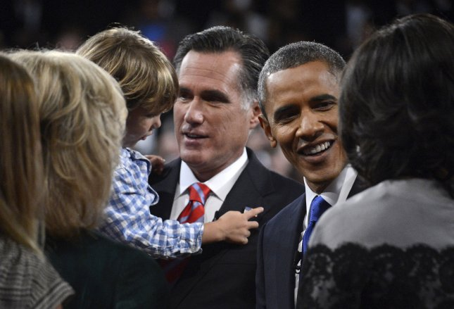 President Barack Obama and Republican Presidential Candidate Mitt Romney talk to members of their families at the end of the final Presidential debate on the campus of Lynn University in Boca Raton, Fla., last week. UPI/Michael Reynolds/Pool