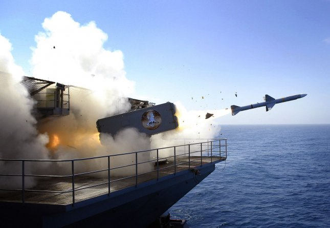 A RIM-7P NATO Sea Sparrow Missile launches from the USS Abraham Lincoln aircraft carrier during a stream raid shoot exercise in the Pacific Ocean on August 13, 2007. Lincoln's self-defense systems fired four Sea Sparrow missiles, engaging and destroying two BQM-74E turbojet-powered drone aircraft and a High-Speed Maneuvering Surface Threat remote controlled Rigid Hulled Inflatable Boat during the exercise. (UPI Photo/Jordon R. Beesley/U.S. Navy).