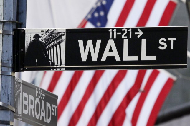 The American Flag seen behind a sign for Wall Street near the New York Stock Exchange. UPI/John Angelillo