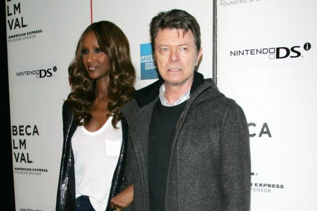 Iman and David Bowie arrive for the Tribeca Film Festival premiere of Moon in New York on April 30, 2009. Photo by Laura Cavanaugh/UPI Bowie's new album Blackstar is set for release Jan. 8.
