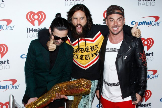 Left to right, Tomo Milicevic, Jared Leto and Shannon Leto of Thirty Seconds to Mars. Jared is traveling across the United States in support of the band's upcoming album America. File Photo by James Atoa/UPI