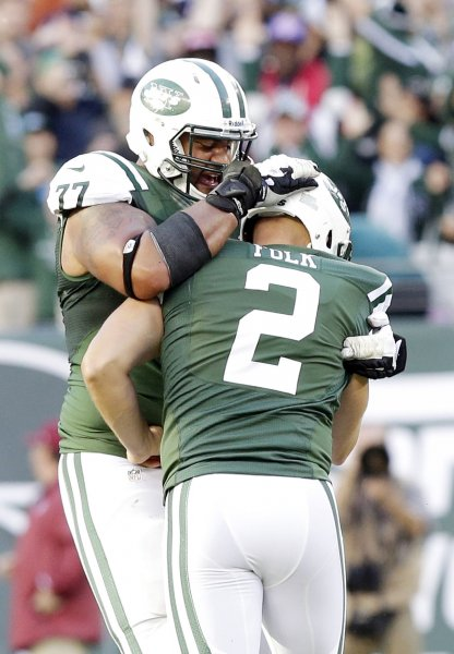 Former New York Jets offensive tackle Austin Howard celebrates with former Jets kicker Nick Folk during a game against the New England Patriots. Howard is reportedly headed to the Indianapolis Colts. File photo by John Angelillo/UPI