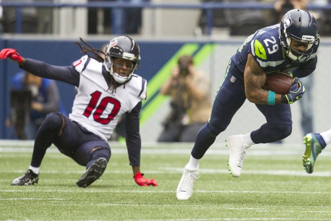 Seattle Seahawks free safety Earl Thomas (29) intercepts a pass intended for Houston Texans wide receiver DeAndre Hopkins (10) and returns it for a 78-yard touchdown in the first quarter on October 29, 2017 at CenturyLink Field in Seattle, Washington. Photo by Jim Bryant/UPI