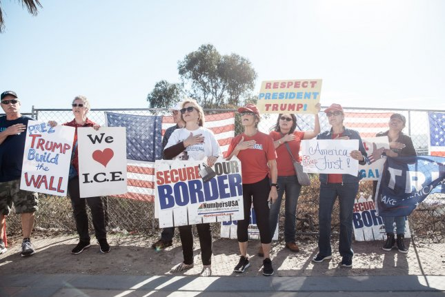 Demonstrators hold signs at an America First rally at the San Ysidro Port of Entry along the United States-Mexico border in San Ysidro, Calif., on Saturday. In a Gallup survey, 16 percent listed immigration as the top problem, which is down from 21 percent the previous month. Photo by Ariana Drehsler/UPI