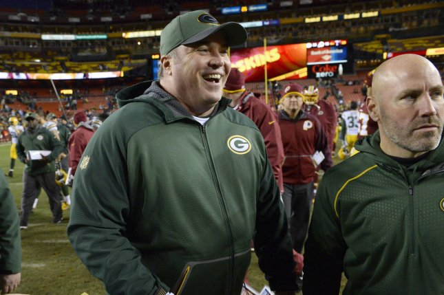 Green Bay Packers head coach Mike McCarthy smiles as he walks off the field after defeating the Washington Redskins 35-18 in their NFC Wild Card game at FedEx Field in Landover, Maryland, January 10, 2016. Photo by David Tulis/UPI