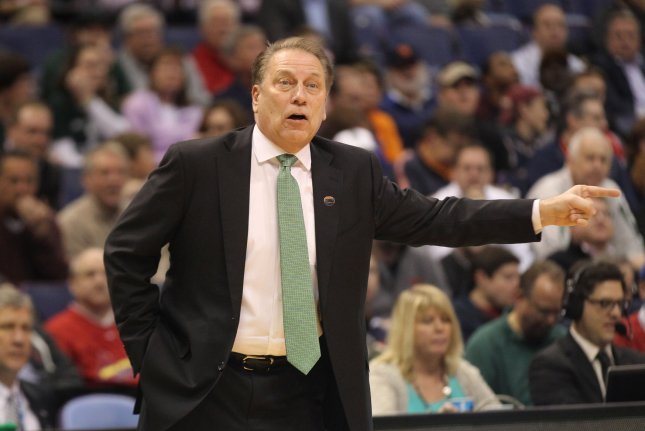 Michigan State Spartans head basketball coach Tom Izzo had to be restrained by players during a huddle after yelling at Aaron Henry on Thursday. File Photo by Bill Greenblatt/UPI