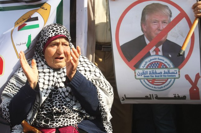 A Palestinian woman chants during a protest in the southern Gaza Strip on Tuesday against the Middle East Peace Plan brokered by U.S. President Donald Trump and Israeli Prime Minister Benjamin Netanyahu. Photo by Ismael Mohamad/UPI
