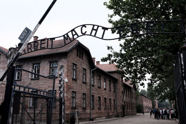 The entrance to the former German Nazi concentration camp Auschwitz I in Oswiecim, Poland, is seen August 1, 2019. On Wednesday, the Claims Conference organization said it negotiated payments from Germany to Holocaust survivors facing economic uncertainty due to the coronavirus. File Photo by Debbie Hill/UPI