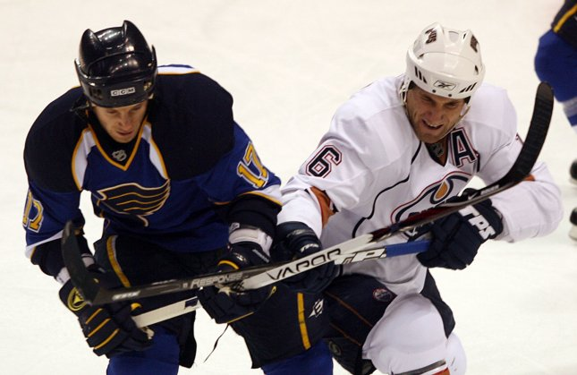 St. Louis Blues Ryan Johnson (L) and Edmonton Oilers Jarret Stoll tie up with their sticks in the first period at the Scottrade Center in St. Louis on January 2, 2008. (UPI Photo/Bill Greenblatt)