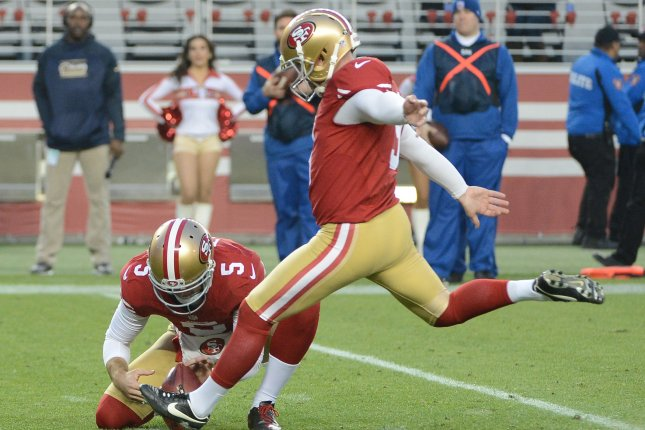 San Francisco 49ers kicker Phil Dawson kicks a 23 yard game winning field goal from the hold of Bradley Pinion (5) against the St. Louis Rams in overtime at Levi's Stadium in Santa Clara, California on January 3, 2016. The 49ers defeated the Rams 19-16 in overtime. Photo by Terry Schmitt/UPI