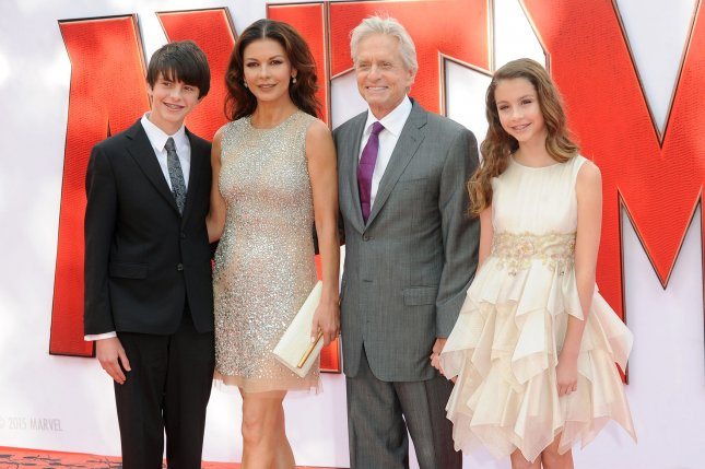 Catherine Zeta-Jones (second from left) with son Dylan, husband Michael Douglas and daughter Carys (L-R) at the London premiere of Ant-Man on July 8, 2015. The actress says her kids want to go into show business. File Photo by Paul Treadway/UPI