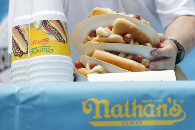 The Louisville Courier-Journal issued a correction to 10 stories dating back to 1887 that incorrectly referred to hot dogs as sandwiches. File Photo by John Angelillo/UPI