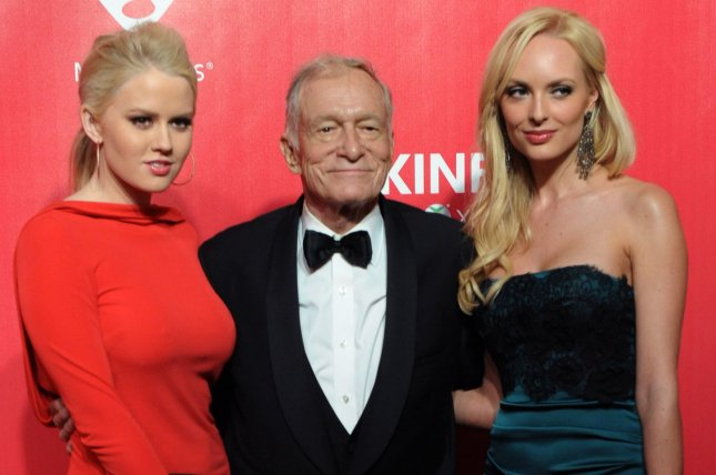 (L-R) Kristina Shannon, Hugh Hefner and Karissa Shannon arrive for the MusiCares Person of the Year Tribute to Paul McCartney on February 10, 2012. The death certificate for Hefner has been released announcing what contributed to his death. File Photo by Jim Ruymen/UPI