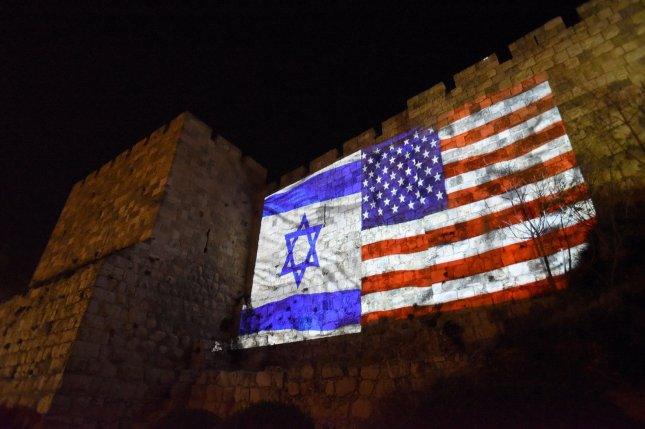 The American flag is projected beside the Israeli national flag on the wall of Jerusalem's Old City on Wednesday. Photo by Debbie Hill/UPI