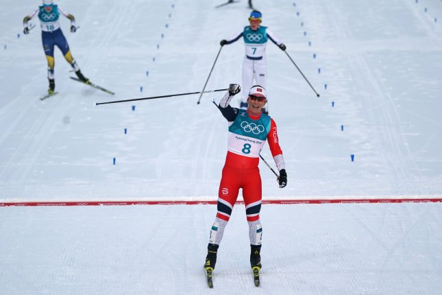 Norway's Marit Bjoergen celebrates as she wins silver in the Ladies' 7.5km + 7.5km Skiathlon cross country skiing event during the Pyeongchang 2018 Winter Olympics on February 10 at the Alpensia Cross-Country Centre in Daegwallyeong, South Korea. Photo by Kevin Dietsch/UPI
