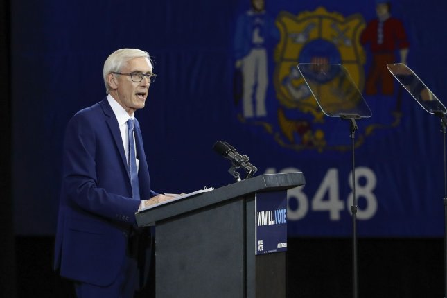 Wisconsin legislatures worked all night Tuesday and into Wednesday on a bill designed to limit the power of Democratic Governor-elect Tony Evers, here at a campaign rally on October 26. File Photo by Kamil Krzaczynski/UPI