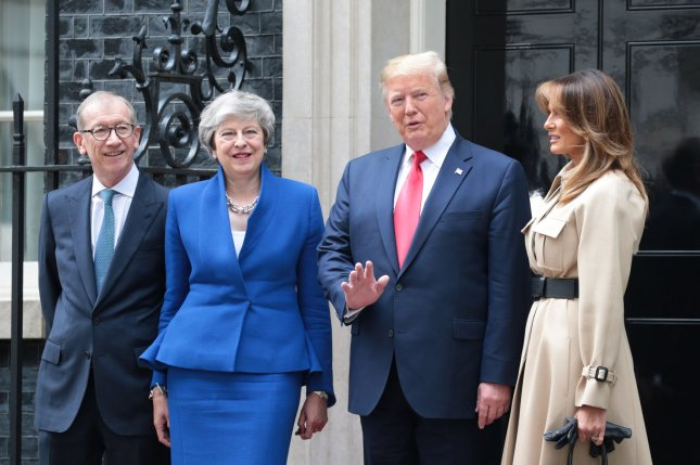 From left to right, Philip May, British Prime Minister Theresa May, President Donald Trump and first lady Melania Trump pose outside No.10 Downing St on the second day of the American President's state visit to London on Tuesday. Photo by Hugo Philpott/UPI