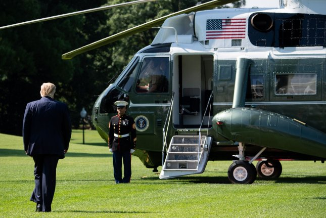 President Donald Trump walks to Marine One Friday as he departs the White House for a day trip to the Midwest. Photo by Kevin Dietsch/UPI