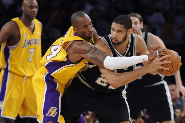 Los Angeles Lakers legend Kobe Bryant (24) and San Antonio Spurs great Tim Duncan (R) were among nine individuals selected for induction into the Naismith Memorial Basketball Hall of Fame in early April. File Photo by Jim Ruymen/UPI