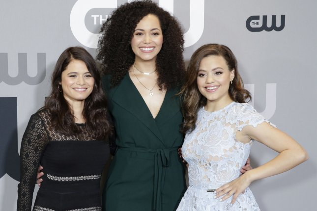 Left to right, Melonie Diaz, Madeleine Mantock and Sarah Jeffery of Charmed arrive on the red carpet at The CW's 2018 upfront in May 2018. Mantock is leaving the series after three seasons. File Photo by John Angelillo/UPI