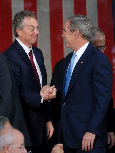 Middle East Envoy Tony Blair (L) shakes hands with U.S. President George W. Bush at the Annapolis Peace Conference in Memorial Hall at the United States Naval Academy in Annapolis, Maryland on November 27, 2007. The meetings are focused at resolving the Israeli-Palestinian conflict with the eventual establishment of a Palestinian state. (UPI Photo/Kevin Dietsch)