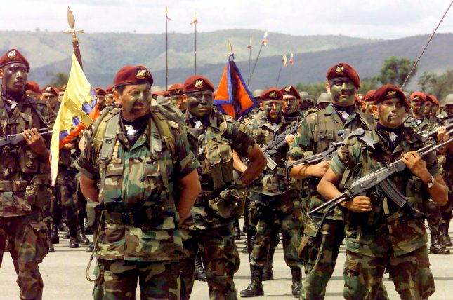 Members of the Colombian military stand in formation at a base near Bogota on December 7, 1999. On June 14, 2015, the Colombian armed forces said it killed a top commander in the National Liberation Front, or ELN, a leftist guerrilla group that is characterized by the U.S. State Department as a foreign terrorist organization. File photo by Rafael Salafranca/UPI